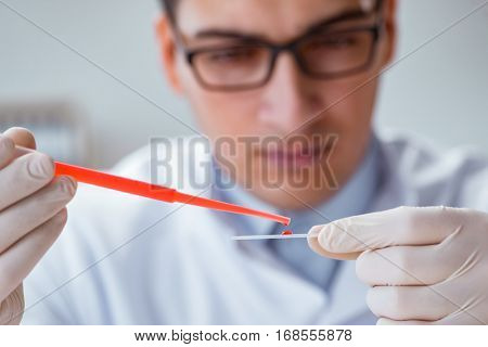 Young doctor doing the blood test