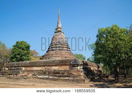 Abandoned stupa is ancient Buddhist temple Wat Chedi Ngarm. Sukhothai, Thailand