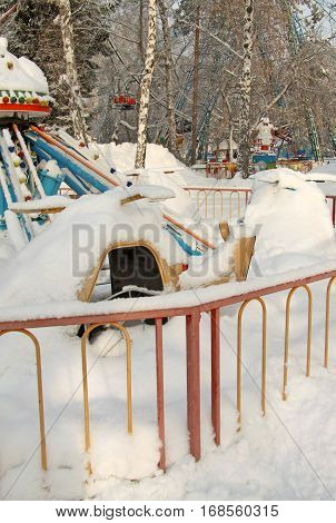 Сarousel Covered With Snow In Amusement Park In Winter