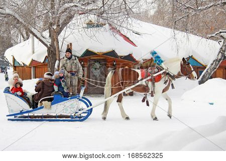 OMSK RUSSIA - JANUARY 14 2017: Horse-drawn carriage rides in winter park