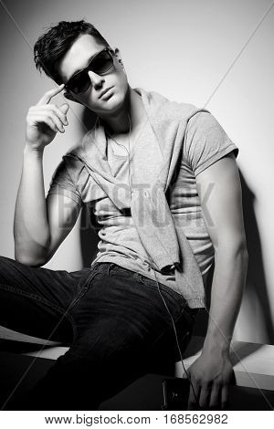 Sexy young man in fashion style. Male model.