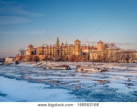 Royal Wawel Castle in winter time with ice floe on the Vistula river, Krakow - Poland