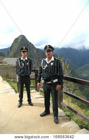 MACHU PICCHU, PERU - OCTOBER 2 , 2016: Tourist police officers at Machu Picchu ruins in Peru.