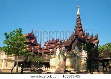 Old pagoda teak wood of Shwe In Bin Kyaung monastery a sunny day. Mandalay, Myanmar
