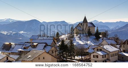 Panoramic view of Saint-Apollinaire village in winter. Hautes-Alpes French Alps France