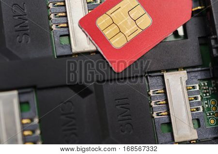 The SIM card slots on your mobile phone. Close up view from the inside. Three places for cards.