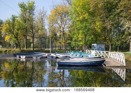 GATCHINA, RUSSIA - SEPTEMBER 24, 2015: Boat station on White lake, sunny September day