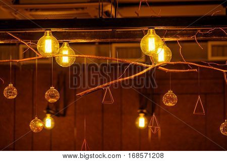 Vintage incandescent lamps as decorative element in a restaurant