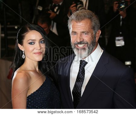 Actor Mel Gibson, Rosalind Ross attend the 'Blood Father' Premiere during the 69th annual Cannes Film Festival at the Palais des Festivals on May 21, 2016 in Cannes, France.