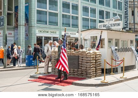 BERLIN, GERMANY- May 18, 2016 : Checkpoint Charlie. Former bordercross in Berlin on May 18, 2016. Berlin Wall crossing point between East and West during the Cold War. BERLIN, GERMANY