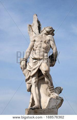 MARIBOR, SLOVENIA - APRIL 03: Saint Sebastian statue, Plague column at Main Square of the city of Maribor in Slovenia, Europe. Historical religious sculpture, April 03, 2016.