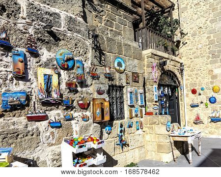 Colorful ceramic souvenirs display at the ancient city wall of Rhodes Town, Greece
