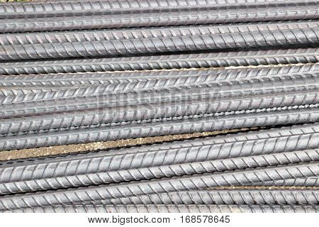 Stock Photo - Steel rods or bars used to reinforce concrete, backgroun