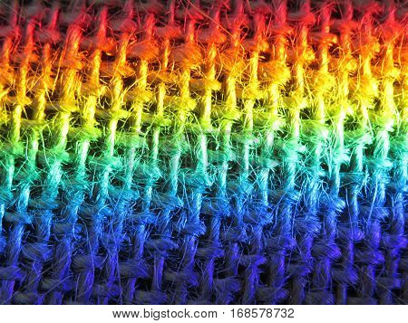 Rainbow prism light reflected on burlap hessian fabric