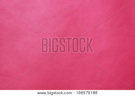 Pink leather texture closeup background. Structured background design nubuk