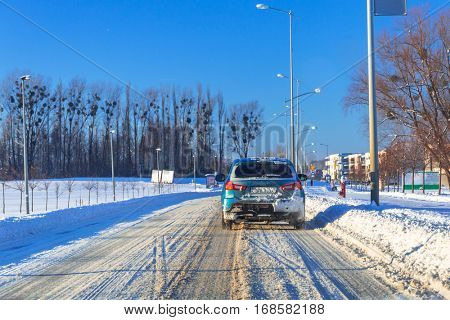 Snowy road after winter snowfall, Poland