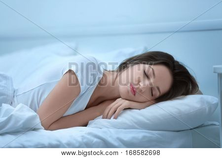 Young attractive woman sleeping in bed at home
