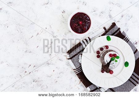 Chocolate Fondant With Cranberry Sauce. Top View