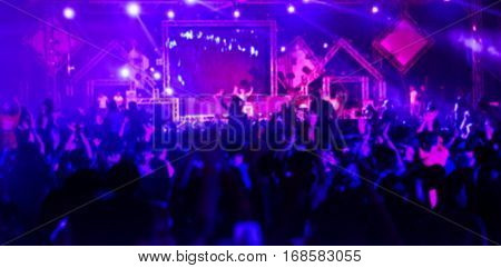 blur dancing in night club for background.