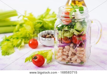 Salad Of White Beans, Tomato, Celery, Cucumber, Arugula, Red Onion And Feta Cheese In A Jar. Diet Fo