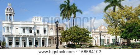Cienfuegos Cuba - 18 january 2016: People walking and taking pictures in front of colonial architecture at the old town of Cienfuegos Cuba