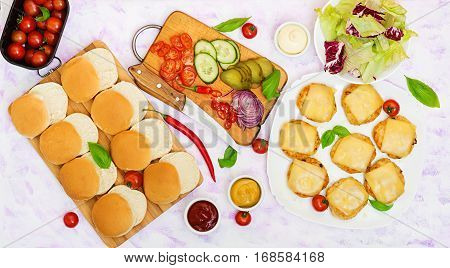 Ingredients For  Hamburgers With Chicken Burger, Cheese And  A Vegetables. Flat Lay. Top View.