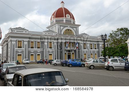 Cienfuegos Cuba - 18 january 2016: people walking in front of the Town Hall at Cienfuegos on Cuba