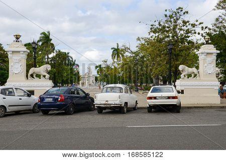 Cienfuegos Cuba - 18 january 2016: people walking through Jose Marti square park in Cienfuegos on Cuba