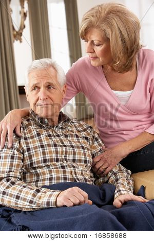 Senior Woman Caring For Sick Husband