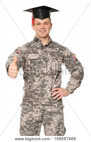 Soldier wearing graduation cap, on white background