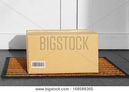 Parcel in cardboard box left on door step