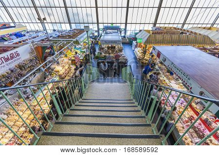 People Enjoy Shopping In The Kleinmarkthalle In Frankfurt, Germany