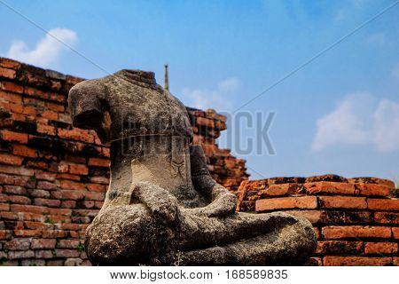 Ancient broken statue of buddha in Ayutthaya Thailand Lot story about history of THAILAND. history concept