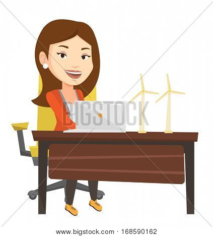Caucasian worker of wind farm working on a laptop. Young engineer projecting wind turbine in office. Worker with model of wind turbine. Vector flat design illustration isolated on white background.