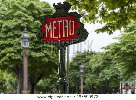 Paris metro street sign at Champs Elysees