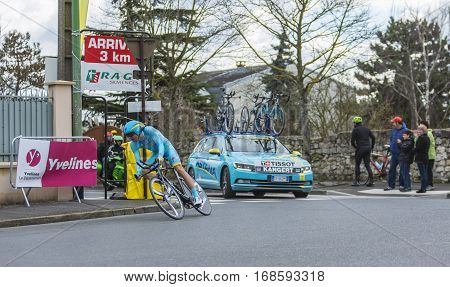 Conflans-Sainte-HonorineFrance-March 62016: The Estonian cyclist Tanel Kangert of Astana Team riding during the prologue stage of Paris-Nice 2016.
