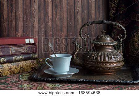 Rustic tea set - vintage interior - book, teapot, porcelain teacup
