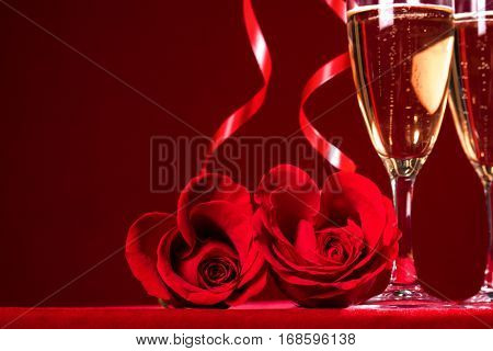 Champagne and heart shaped roses with copy space