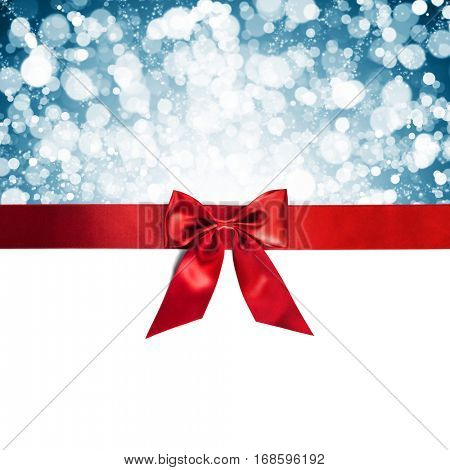 Red gift ribbon bow and blue bokeh isolated on white background