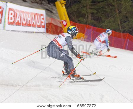 STOCKHOLM SWEDEN - JAN 31 2017: Stefano Gross (ITA) and competitor in the downhill skiing in the parallel slalom alpine event Audi FIS Ski World Cup. January 31 2017 Stockholm Sweden