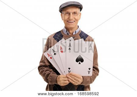 Cheerful mature man holding four aces isolated on white background