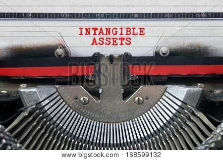 INTANGIBLE ASSETS Typed Words On a Vintage Typewriter Conceptual