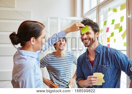 Students in team building game with sticky notes