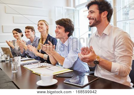 Start-up team clapping hands of consent at group presentation
