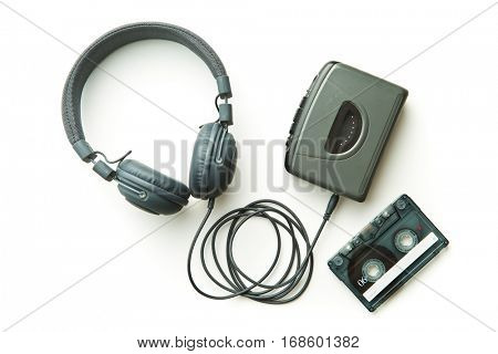 Vintage audio player, audio tape and headphones isolated on white background.