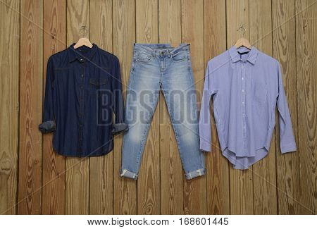 Set of Jeans shirt with Blue jeans trousers, shirt - wooden background