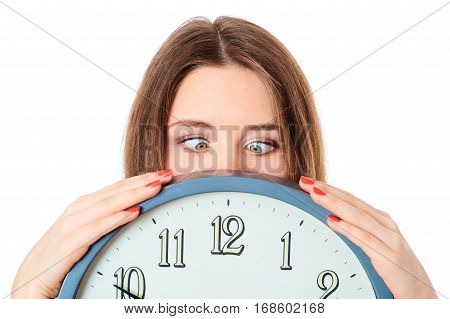 Woman holding clock  with wondering eyes foolishly.