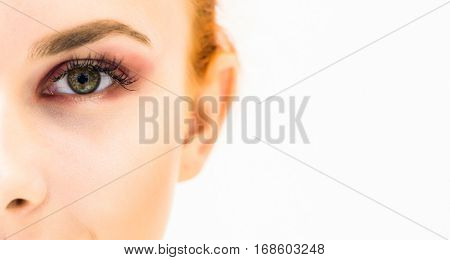Close-up of eyebrows and eyes on a light background