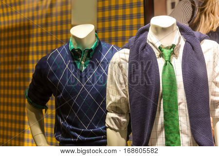 Male mannequins in modern youth clothes