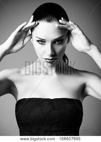 Studio fashion shot: portrait of a beautiful young woman. Black and white